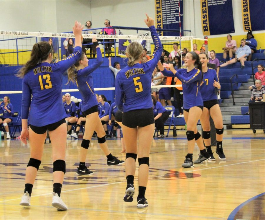 The+Wilton+Volleyball+team+celebrates+a+point+against+West+Liberty+on+September+17.