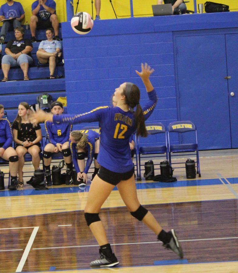 Caffery serves during the West Liberty match on September 17.