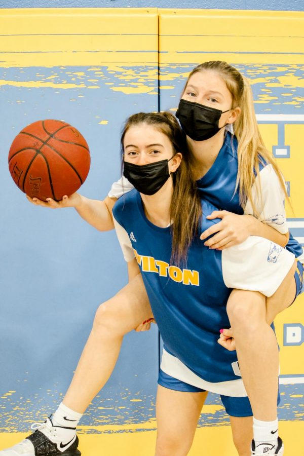 Mallory Lange (22') and Kelsey Lockhart (22') pose for a quick picture before their game.