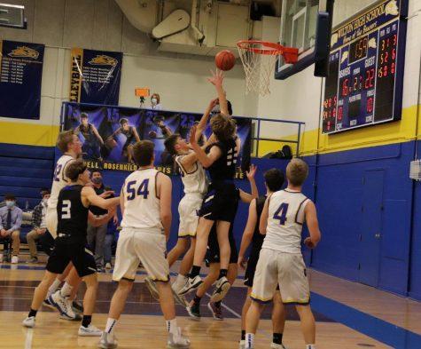 Wilton Boy's Basketball Wins in the Dark